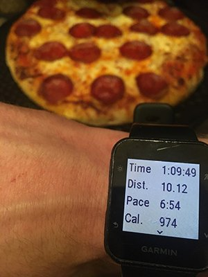 Pizza and watch showing running stats