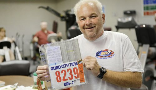 Glen Griffith poses with race packet