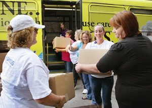 Items donated by Genesis employees are loaded onto a bus to help fill local food pantries.