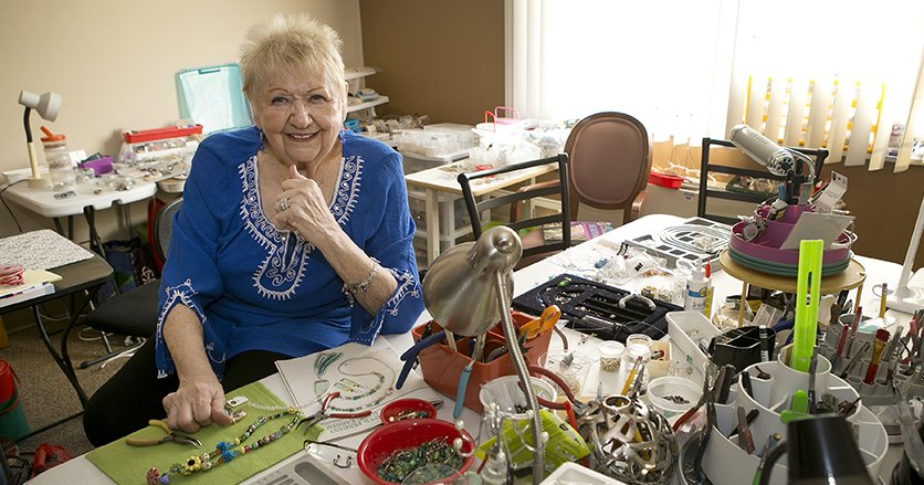 Geneieve Bennett helps other residents create crafts