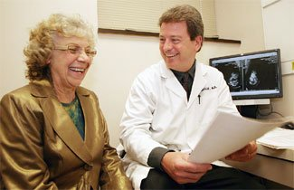 Marsha Pedersen shares a light moment with her breast surgeon, Dr. Joseph Lohmuller.