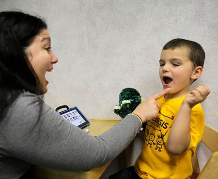 Gavin Staab gets speech therapy with Speech Pathologist MaryBeth Myers