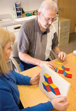 Jerry Ward completes a puzzle during a session with speech pathologist Lori Dryg.