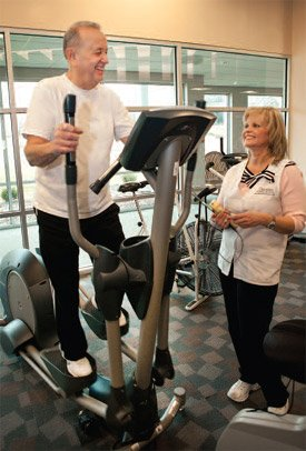 Dick Patterson of Davenport exercises in Phase 3 Cardiac Rehabilitation while talking to Genesis RN Nancy Pribyl at the Genesis Heart Institute.