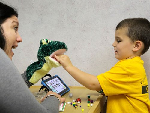 Speech Pathologist MaryBeth Myers works with her patient, Gavin Staab.
