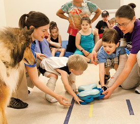 Genesis Outpatient Pediatric Therapy Center invited a certified therapy dog to join in therapy. With the help of occupational therapists Kristen Mandle and Ashley Larson, children worked to gain better fine motor coordination and movement in their hands.