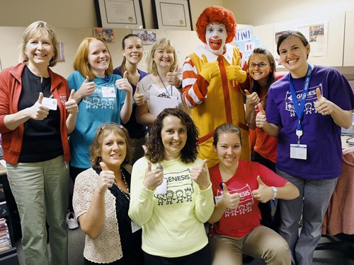 The team at the Genesis Outpatient Pediatric Therapy Center visit with Ronald McDonald.