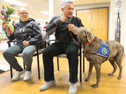 Cesar Millan met cancer patient Shiela Jasper of Davenport and the hospital's therapy dog, Logan
