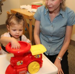 Deb Crooks, pediatric speech therapist, works with a client during an individual speech session.