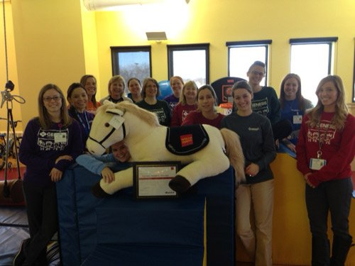 The team at the Genesis Outpatient Pediatric Therapy Center pose with their new pony donated by Wells Fargo