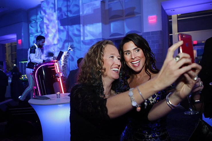 Party-goers taking selfie
